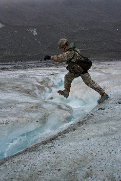 A Soldier at the U.S. Army Northern Warfare Training Center trains on a glacier.