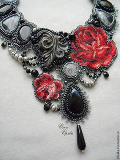 Neckpiece by Russian beader Olga Orlova. Bead embroidery, peyote stitch bezels.  Seed beads, glass beads and pearls, various carved stone cabochons and stone dangles.