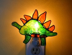 Hey, I found this really awesome Etsy listing at http://www.etsy.com/listing/129046144/hendrik-the-stegosaurus-stained-glass
