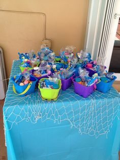 Little mermaid party-Net on favor table and dessert table.
