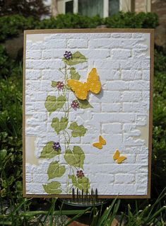 "One of the cards I'll be sending to OWH. I almost have the box filled!! The bg is ""bricked"" by Sizzix/Tim Holtz. I inked up the embossing folder with antique linen before sending it through my cuttlebug. I stamped the ivy before sending it through, too. The butterflies are a MS punch. TFL! K5313 Silhouette Ivy HA flower gems Sizzex ""bricked"" MS butterfly punch"