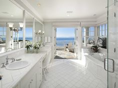 Comedian Dennis Miller Is Selling His Gorgeous California Beach Home For $22.5 Million - The pristine master bath has an oversized shower and a nautical full bath.