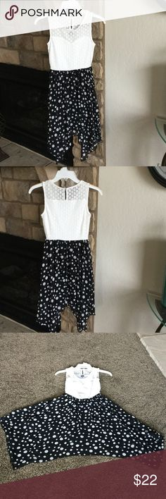 Disney Minnie rocks the dots polka dot dress Black & white lace torso chiffon skirt fully lined.  Laying flat bust 13 inches, waist 10 1/2 inches, shoulder to hem 30 inches.  Cute uneven hem.  Worn one time Disney Dresses Mini