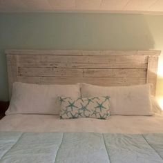 King headboard made from pallet wood, painted and distressed using white chalk paint.