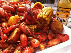 crawfish with seasoning and beer in tray