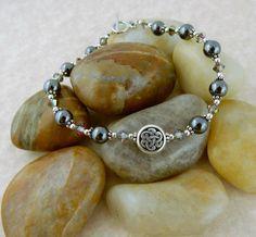 Celtic Knot beaded bracelet with hematite gemstone and Swarovski crystal beads…
