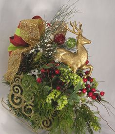 Deer and Sleigh Christmas Arrangement Christmas Flower Arrangements, Gold Christmas Decorations, Holiday Centerpieces, Christmas Tablescapes, Christmas Wreaths, Christmas Crafts, Christmas Sleighs, Christmas Ornaments, Holiday Crafts
