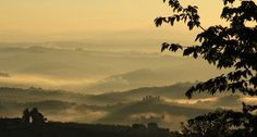 Early morning mist and smoke photographed from the walls of San Gimignano, Tuscany, Italy.
