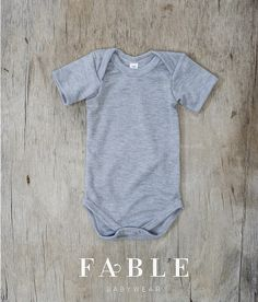 Keeping it simple with grey on grey! Our navy Fable Babywear Bib finishes off this look perfectly. View our Vest Collection at www.fablebabywear.com