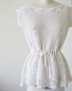 1970s vintage crochet tunic top with a scoop neck and a drawstring belt that can adjust waist. 100% cotton. Fits like: Small Label: Small / South Pacific Apparel Honolulu / Made in Philippines Color: Off white Condition: Excellent Bust 36 Waist 36 Length 24 Dress form size 6 *All