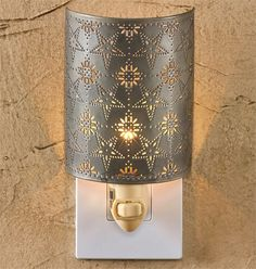 This Punched Tin Star Night Light from Park Designs adds comfort and safety to your bedroom, hallway, or bath. Punched star design gives off a filtered design. Night Lite, Star Night Light, Baby Night Light, Stars At Night, Punched Tin Patterns, Decorative Night Lights, Tin Star, I Love Lamp, Copper And Brass