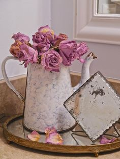 Chateau Chic: Easy Summer Decorating Using Roses love this little mirror