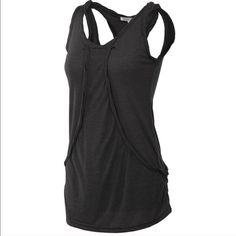 Mock layered tank I have black and white available. This tank is the best at hiding muffin top and love handles . Makes a flattering addition to your summer wardrobe  price is firm on this item I have Large and small in black  Monoreno Tops Tank Tops