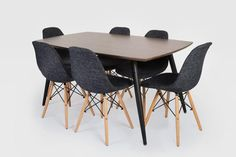 Tia Dining Table Dark wood MDF table Black metal legs x x cm Nakaa Black Dining Chair Fabric seat Beech wood legs with metal support x x cm