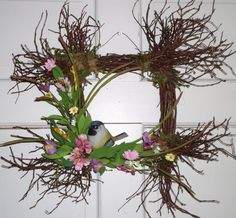 Square Spring Door Wreath decorated with natural moss, pastel wildflowers and a resin chickadee     The unique square base is made of wild blueberry twigs.    The square itself measures 10 x 10, complete with the wispy branches it measures 20 x 20    The flowers are made of foam and paper creating a beautiful natural wildflower look.    ****Recommended for indoor use or a spot that is protected from the outdoor elements.    To see more of my designs please visit me at:  https://www....