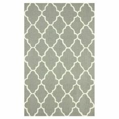 Stylishly anchor your living room or master suite with this hand-hooked wool rug, showcasing a lovely trellis motif in dark grey.   Product: RugConstruction Material: 100% WoolColor: Dark greyFeatures: Hand-hooked Note: Please be aware that actual colors may vary from those shown on your screen. Accent rugs may also not show the entire pattern that the corresponding area rugs have.Cleaning and Care: These rugs can be spot treated with a mild detergent and water. Professional cleaning is ...