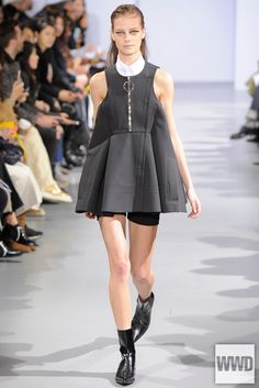 This dress from the Paco Rabanne RTW Fall 2015 Collection takes its fashion influence from the 1960's. The style tribe of the 1960's that this outfit is pulling inspiration from are the Mods. The small white collar and somewhat school girl appearance to this dressed were style features that Mary Quant popularized. Style line wise, this dress also pulls from the mods with the short length and not trapeze silhouette.2/27