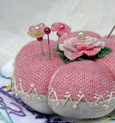 This lovely vintage inspired pin cushion is a bit of old and new all rolled into one. The top is up-cycled silk and wool blend.♡