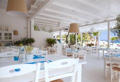 This new seafront restaurant offers a rich menu of Greek dishes and Mediterranean delights in a charming surrounding of typical Cycladic architecture. Greek Restaurants, Greek Dishes, Restaurant Offers, Sea Side, Greeks, Postcards, Hotels, Holidays, Table Decorations
