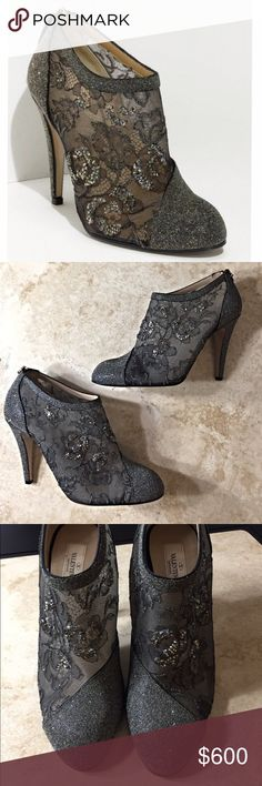"""Valentino Crystal Embellished Lace Booties An angled panel of lace-dotted with crystals cuts across a glamorous suede bootie crafted from lush suede and beautiful lace covered in tiny crystals. Back zip closure, heel height approx 4"""" inches, boot shaft height approx 2 1/2"""" inches. Suede upper leather lining and sole. True to size. Excellent condition. Minor wear to the bottom soles. All reasonable offers are welcome! Please make all offers through the offer button🤗 Valentino Shoes Ankle…"""