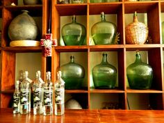 At Cuish Mezcal bar in Oaxaca. Mezcal is a liquor that's similar to tequila, but it has a smokier flavor and it's often served with chili salt and orange slices. Beach Restaurant Design, Restaurant Bar, Mexican American, Mexican Art, Website Images, Liquor, Bottle, Corks, Orange Slices