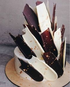 Dark & White Brushstroke Cake | Top 8 Brushstroke Cakes Pinterest | In the past few days, while scrolling through the wonderful world of Pinterest, I have been noticing a certain style of cake popping up. A certain type of cake that seems so simple, and looks so effective, but has not yet had it's time in the lime light yet. | http://angelfoods.net/top-8-brushstroke-cakes/