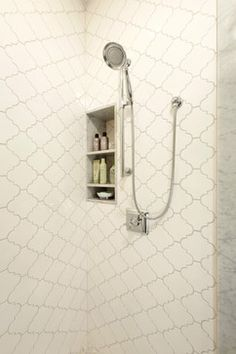 A hand-held showerhead on a sliding bar can be adjusted to the right height for anyone using it and you get the added benefit of being able to easily wash your shower or tub by removing the showerhead from its cradle. For guest bathroom.