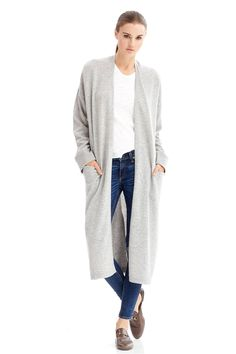 420 grams of 100% pure cashmere in 12-gauge knit Sleek open front cardigan Front patch pockets Slit on the back Hand Wash Naked or Dry Clean Only