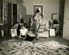 Edith Head and Grace Kelly look at a sea of fashion sketches. Head costumed Kelly in Rear Window (1954) and designed the ice-blue satin gown that Kelly wore to receive her 1955 Academy Award for The Country Girl (1954).   FIT