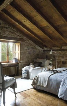 love the wooden ceiling and the couch by the window!