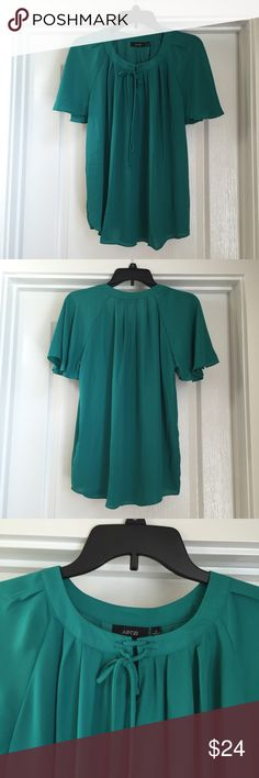 Blouse Brand new! Will need to be ironed before wearing. Fits loosely. The material is thin and perfect for spring/summer although you might need to wear a tank top underneath. Tops Blouses