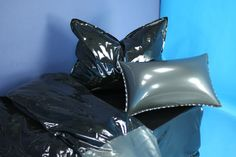 latex bedding - black / metallic pewter , with metallic-peacock latex catsuit