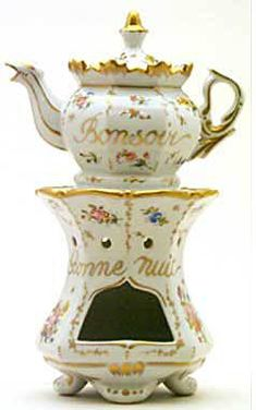 "Teapot #465 Hexagonal pot and base, fluted at top of pot, scalloped at top of base; gold trim outlines each panel in which delicate pink flowers enhance the overall beauty. French good evening, ""Bon Soir"", traced in gold on pot."