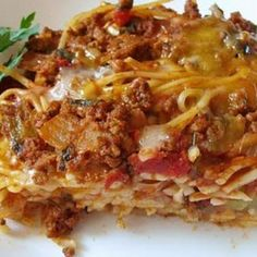 Baked Spaghetti Recipe Main Dishes with noodles, onions, green pepper, margarine, chopped tomatoes, oregano, garlic, ground beef, mozzarella cheese, cream of mushroom soup, water, parmesan cheese