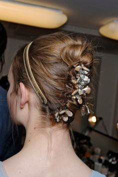 Jeweled Clips: Adding floral clips to an unmistakingly messy updo may seem like overkill, but when the look is anchored by a traditional chignon, it all seems to work. Here, at Tory Burch, the models sported Burch's crystal floral clips, haphazardly peeking out of a disheveled twist.