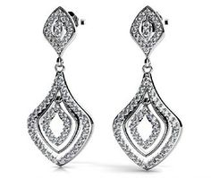 These diamond dangle earrings in 14k white gold feature 58 round cut diamonds in each earring, for a total of 116 diamonds. Approximately 1 1/8 carat total diamond weight by www.brilliance.com