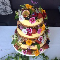 Wedding Cake Cheesecake tower! T-B lemon, vanilla bean & fresh strawberry baked cheesecakes with #glutenfree bases. Stunning wedding @raesonwategos ❤️. All flowers edible from my garden! My dads passionfruit vine & lavender and as much as possible local ingredients. Loved this so different, brief was healthy & bright with toasted coconut edges