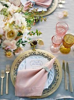 Lovely gold and pink table setting with a vintage feel from the glasses.