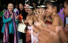 U.S. Secretary of State Hillary Rodham Clinton, left, claps to the music as dancers pose with her while visiting the Timor Coffee Cooperative in Dili, East Timor Thursday, Sept. 6, 2012. (AP Photo/Jim Watson, Pool) ▼6Sep2012AP|Clinton in East Timor on democracy push http://bigstory.ap.org/article/clinton-east-timor-democracy-push #Dili #East_Timor #Timor_Lorosae #Hillary_Clinton