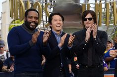Chad L Coleman Steven Yeun Norman Reedus visit 'Extra' at Universal Studios Hollywood on October 3 2013 in Universal City California