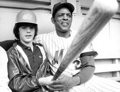 John F. Kennedy, Jr. and Willie Mays pose for a photo at Shea Stadium in 1972. Mays is celebrating his 81st birthday on Sunday. (Jerry Siskind/Getty Images)