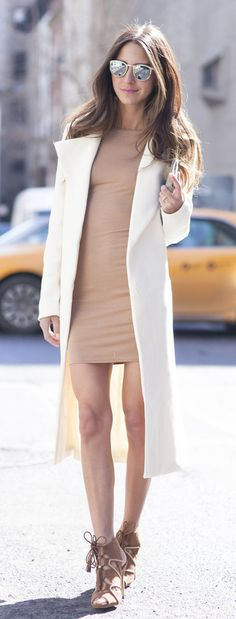 Arielle Nachami is wearing a camel dress, white coat and brown shoes, all from Missguided