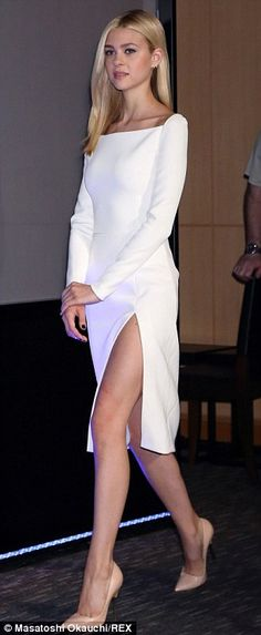 Striking: The 19-year-old star opted for an elegant white dress and nude heels to promote ...