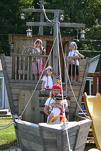 I think this is such an awesome idea for outdoor environment! Making the big toy into something like a ship allows the children to explore dramatic play outside, as well as inside.