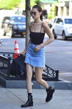 90 celebrity denim looks to copy: Kendall Jenner sports a jean mini skirt, black tank top, and black booties
