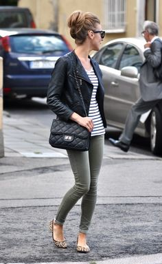 Classic outfit: Striped shirt, olive green skinnies, leopard flats, black leather motorcycle jacket, and a quilted leather bag.