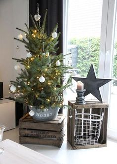 If we've convinced you enough, look at our gallery of potted Christmas tree decoration ideas below. Potted christmas trees, potted trees for christmas. Potted Christmas Trees, Noel Christmas, Country Christmas, Simple Christmas, Christmas Tree Decorations, Christmas Crafts, Potted Trees, Small Christmas Tree Decor, Minimal Christmas
