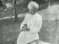 When a man loves cats , I am his friend and comrade, without further introduction. - Mark Twain