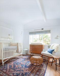 Great statement rug in this slightly boho nursery! | amberinteriordesign.com