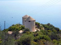 Another beautiful landscape of Tyros in Eastern Peloponnese, Greece. A town with an amazing natural beauty that you should certainly visit during your summer vacations. Greece Vacation, Summer Vacations, Windmills, Beautiful Landscapes, Places To Travel, Natural Beauty, Amazing, Beach, Nature